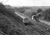 The 11.51 Leeds to Sheffield via Barnsley stopping train recedes from the camera and makes for its next stop at Wakefield Kirkgate in April 1976, having just passed Lockes Sidings signal box [see image 37445]. Notable features on the horizon are Emley Moor TV transmitter just to the left of the train and the spire of Wakefield Cathedral near the right hand edge of the picture.<br><br>[Bill Jamieson&nbsp;03/04/1976]