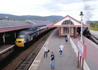 The up GNER <I>'Highland Chieftain'</I> HST calls at Aviemore in May 2002. On the right is Ivatt 2MT 4-6-0 no 46512 with a recent arrival from Boat of Garten standing at the Strathspey Railway platform.<br><br>[John Furnevel&nbsp;11/05/2002]