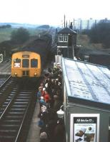 Crowds celebrate the first day of re-opening at Kingsknowe station on 1 Feb 1971. The station, opened in 1848 (originally as King's Knowes), had been closed by BR in July 1964. The red notice in the cab window of the Waverley bound DMU reads <I>'Kingsknowe station reopens today'</I>.<br><br>[David Spaven&nbsp;01/02/1971]