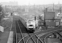 An April afternoon in 1980, standing on the footbridge at Slateford station in the Edinburgh suburbs. Locomotive 47703 <I>'St Mungo'</I> is rapidly approaching heading south west towards Carstairs with the 13.22 Edinburgh - Taunton.<br><br>[John Furnevel&nbsp;13/04/1980]