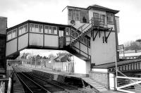 View west towards Dundee from Gray Street level crossing, Broughty Ferry, in March 1993. Note the door built into the covered footbridge providing access to the signal box stairway.<br><br>[Bill Roberton&nbsp;/03/1993]