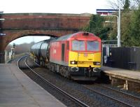 A pleasant change from the more mundane looking Class 66s that normally handle the Lindsey Oil Terminal to Preston Docks tar tank trains. No 60011, in DBS red livery, hauls the returning empty tanks through Lostock Hall on 15 February 2012.<br><br>[John McIntyre&nbsp;15/02/2012]
