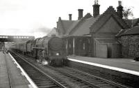 An up express hauled by a Standard <I>Clan</I> Pacific runs through Beattock station in July 1962.<br><br>[R Sillitto/A Renfrew Collection (Courtesy Bruce McCartney)&nbsp;14/07/1962]