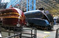 The recent rebuild of 6229 <I>Duchess of Hamilton</I> with new streamlined casing has been well documented but is almost breathtaking when first seen at the NRM. The LMS Pacific is sited alongside its LNER A4 rival and is displayed with an LMS coach, also in red with gold stripes. The UK preservation movement is achieving things that would have been unthinkable a few years ago.<br><br>[Mark Bartlett&nbsp;02/02/2012]
