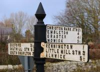On each of the 3 Arms of this still well-maintained Northumberland road sign, set at bearings of 0, 90, and 180 degrees., the traveller is directed to an ECML station. An intending passenger may well be somewhat dissappointed - Chathill Station., two trains per day. Christon Bank Station., closed to passengers 1958, closed completely 1965, converted station building and goods shed remain [see image 21787]. Little Mill Station., closed to passengers 1958, closed completely 1965, long demolished!<br><br>[Brian Taylor&nbsp;/02/2012]