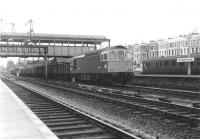 The sprawl that was Kensington Olympia in June 1969, with Type 3 'Crompton' no D6570 taking a freight south on one of the through roads towards Clapham Junction. At that time various bays and sidings still stood on both sides of the running lines, together with significant areas of unused former railway land, but not for very much longer [see image 5189].<br><br>[John Furnevel&nbsp;05/06/1969]