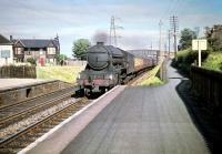 The down <I>Flying Scotsman</I>, still some 3 miles out from Waverley, coasts through Joppa station on the afternoon of 6 July 1959. Gateshead A3 Pacific no 60040 <I>'Cameronian'</I> is the locomotive in charge on this occasion. <br><br>[A Snapper (Courtesy Bruce McCartney)&nbsp;06/07/1959]