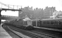 A diverted ECML service at Carlisle on Saturday 25 April 1964. Deltic D9010 <i>'The King's Own Scottish Borderer'</i> runs through platform 4 with the 9.30am Glasgow Queen Street - London Kings Cross. The Deltic had taken charge from Edinburgh and had reached Carlisle via the Waverley Route. After passing through the station the train would turn east onto the Newcastle & Carlisle line. [With thanks to Paul Bettany]<br><br>[K A Gray&nbsp;25/04/1964]