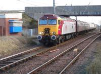 Virgin 'Thunderbird' no 57304 <I>Gordon Tracy</I>, on hire to GBRf to handle the 334020 drag to Brodie Rail Works, Kilmarnock. The locomotive is seen on 3 February 2012 leaving Barassie sidings with a train from the Kilmarnock works consisting of 'translator' vehicles for Glasgow Works and coaches for SRPS Bo'ness.<br><br>[Ken Browne&nbsp;03/02/2012]