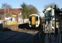 A Southeastern service from Ramsgate to London Charing Cross via Ashford passes the down platform and signalbox at Sturry, near Canterbury, on 23 February 2012. The train is about to call at the up platform on this side of the level crossing.<br><br>[John McIntyre&nbsp;23/02/2012]