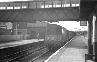 An EE Type 1 brings a freight south through Beattock station in the summer of 1962.<br><br>[R Sillitto/A Renfrew Collection (Courtesy Bruce McCartney)&nbsp;14/07/1962]