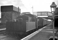 The single coach St Boswells - Berwick branch train stands alongside the platform at Kelso on 10 September 1962. Hawick shed's standard class 2 2-6-0 no 78049 is the locomotive in charge.<br><br>[R Sillitto/A Renfrew Collection (Courtesy Bruce McCartney)&nbsp;10/09/1962]