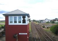 Looking south from the footbridge over the level crossing at Carnoustie in August 2006 towards the site of the original 1838 station, replaced in 1900 by the current structure, located on the north side of the crossing behind the camera.<br><br>[John Furnevel&nbsp;12/08/2006]
