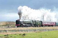 The outbound <I>'Cumbrian Mountain Express'</I> of 25 February 2012 photographed on Shap heading for Carlisle behind Britannia Pacific no 70013 <I>Oliver Cromwell</I>.<br><br>[Jim Peebles&nbsp;25/02/2012]