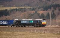 DRS 66423 with the 4D47 Inverness - Mossend intermodal service just south of the former Dalguise station on 25 February 2012.<br><br>[Bill Roberton&nbsp;25/02/2012]