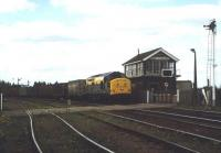 A class 37 hauled container train runs over the level crossing at March South Junction in June 1997 heading south east towards Felixstowe.<br><br>[Ian Dinmore&nbsp;/06/1997]