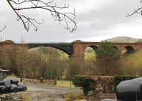 But for the Midland and LNWR falling out, the Clapham to Lowgill railway would have been the main line to Scotland from West Yorkshire. It was certainly built like a main line as three great surviving bridges at Ingleton, Lowgill and Sedbergh testify. This is the Sedbergh bridge, in cast iron and brick, striding across the Lune Valley.<br><br>[Mark Bartlett&nbsp;25/02/2012]