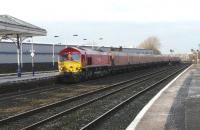 Red liveried DBS 66097 with HTA empties southbound for New Cumnock emerging from Kilmarnock Long Lyes on 2 February 2012.<br><br>[Ken Browne&nbsp;02/02/2012]