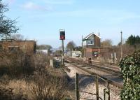 The signalbox at Minster looking west towards the station on 23 February 2012. The photograph is taken from the middle of a triangular junction with lines running past towards Dover (left) and Ramsgate (right). There had been a number of railway staff in hi-viz clothing in the area earlier, however, at this point in time they were behind the signalbox assisting with the removal of a trespassing goose!<br><br>[John McIntyre&nbsp;23/02/2012]
