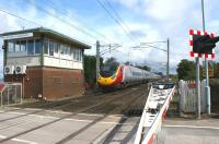 A northbound Pendolino has just passed Hest Bank level crossing frame box on 11 August 2009.<br><br>[John McIntyre&nbsp;11/08/2009]