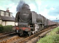 Stanier Pacific no 46241 <I>City of Edinburgh</I> photographed at Symington with a down train in the summer of 1959.<br><br>[A Snapper (Courtesy Bruce McCartney)&nbsp;01/08/1959]