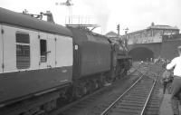 Taking on water at Blackburn on 4 August 1968 is BR Standard class 5 4-6-0 no 73069. The locomotive had recently arrived from Manchester Victoria [see image 31774] with the RCTS <I>'End of Steam Commemorative Railtour'</I> piloted by 8F no 48476. The 8F was about to be replaced by Black 5 no 45407 for the journey to Lostock Hall via Hellifield, Skipton and Burnley. The special would return to Euston later that day from Stockport behind E3183.<br><br>[K A Gray 04/08/1968]