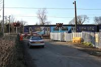 On the day the contractors moved in to upgrade Bolton-le-Sands level crossing, 150228 passes on a Morecambe to Leeds service. The station, closed in 1969 and removed, was on the right of the picture [See image 20171]. Nearby Hest Bank and Bare Lane crossings are also being modernised during Spring 2012 with their signal boxes scheduled to disappear. (See News item.)<br><br>[Mark Bartlett&nbsp;05/03/2012]