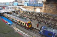 View over the former suburban platforms at Waverley on 6 March 2012, with class 334 and 380 units and a pair of CrossCountry Voyagers visible. Work is well underway on the refurbishment of the canopies and the accesss stairway.<br> <br><br>[Bill Roberton&nbsp;06/03/2012]