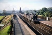 One of St Margarets shed's J37 0-6-0s no 64576 brings a freight off the Forth Bridge on a pleasant August afternoon in 1959 as it drifts south through Dalmeny station.<br><br>[A Snapper (Courtesy Bruce McCartney)&nbsp;08/08/1959]