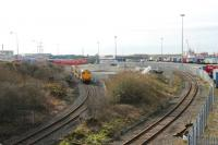 Panorama of Heysham Port area on 6 March 2012 as DRS Class 20 20309 leads two flasks plus 20308 down the short branch from the power station. On the right is the line leading to the passenger station at the Port terminal. The lines meet just under the bridge from which the photograph was taken.<br><br>[Mark Bartlett&nbsp;06/03/2012]