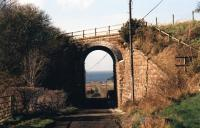 'Light railway' engineering north of Maidens in March 2012: masonry bridge with blue engineering brick arch over track from Morriston to Ardlochan looking west.<br><br>[Colin Miller&nbsp;03/03/2012]