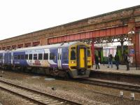 Northern Rail 158903 calls at Wakefield Kirkgate on 2 March with the 15.23 service to Nottingham ex-Leeds. Meantime, in the background, Centro liveried 150119 - with Northern logos and a hidden Northern liveried 153 attached - waits at Platform 3 to form the 15.31 to Knottingley.<br><br>[David Pesterfield&nbsp;02/03/2012]