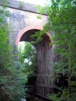 Just to the east of the former Gilsland station the Newcastle - Carlisle line crosses the Poltross Burn on this impressive structure. <br><br>[Andrew Wilson&nbsp;06/09/2011]