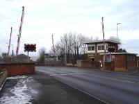 Low Gates level crossing and signal box at Northallerton in February 2012. View north west along the A167 over the Yarm and Eaglescliffe line.<br><br>[David Pesterfield&nbsp;12/02/2012]