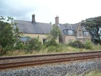 View north across the Newcastle & Carlisle line in September 2011 towards the former Gilsland station. Closed to passengers in 1967, the building is now a private residence. [See image 22045]<br><br>[Andrew Wilson&nbsp;06/09/2011]
