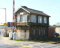 The substantial stone signal box alongside the busy level crossing at Castlegate, Malton, looking south in May 2009. Malton station is half a mile off to the right [see image 23497].<br><br>[John Furnevel&nbsp;22/04/2009]