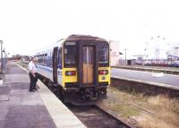 The guard about to board a 153 unit at Cleethorpes station in August 1995 due to leave on a Saturday service to Barton on Humber.<br><br>[Ian Dinmore&nbsp;12/08/1995]