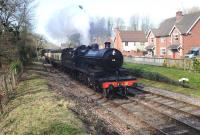 Former Somerset & Dorset 2-8-0 No 88 arriving at Crowcombe Heathfield Station on 11 March 2012.<br><br>[Peter Todd&nbsp;11/03/2012]