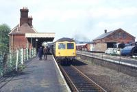 A DMU calls at Chappel and Wakes Colne on the Marks Tey - Sudbury branch in May 1979. This is also the location of the East Anglian Railway Museum, the main building of which stands on the right. <br><br>[Ian Dinmore&nbsp;03/05/1979]