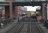 There is a distinct Western Region feel to Bury Bolton Street station on the heritage East Lancashire Railway in this view south from the tunnel mouth on 3 March 2012. On the left is Class 14 no D9531, recently extensively overhauled and now running as the 'new' D9556 while on the right is Class 35 no D7076.<br><br>[John McIntyre&nbsp;03/03/2012]