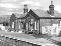 The paint brush is out at Oxenhope on 28 March 1976, all part of getting the station spick and span for Easter, which is only a few weeks away. <br><br>[Bill Jamieson&nbsp;28/03/1976]