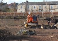 The site of Dunfermline Locomotive Depot is being redeveloped. View north to the retaining wall below the old main line, now a footpath, on 11 March 2012.<br><br>[Bill Roberton&nbsp;11/03/2012]