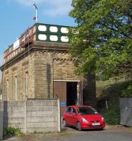 The former water tower at Settle was in the throes of its successful conversion into a house by ex-Friends of the Settle and Carlisle Line chairman Mark Rand and his wife Pat when this picture was taken in April 2011. The project featured in the Channel 4 programme 'The Restoration Man'.<br><br>[Andrew Wilson&nbsp;18/04/2011]