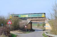 Scene at Longcot on the eastern edge of Swindon on 15 March with Freightliner 66567 passing on an eastbound container train.<br><br>[Peter Todd&nbsp;15/03/2012]