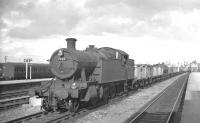 Collett 2-8-2T no 7228 passing through Swindon station with a down freight in October 1961.<br><br>[K A Gray&nbsp;06/10/1961]