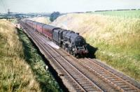 Corkerhill shed's Black 5 no 45251 photographed just south of Lugton with an up train in the summer of 1959.<br><br>[A Snapper (Courtesy Bruce McCartney)&nbsp;22/08/1959]