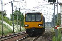 A Northern service from Heysham Port to Leeds on 19 June 2010 approaching the level crossing at Bolton-le-Sands.<br><br>[John McIntyre&nbsp;19/06/2010]
