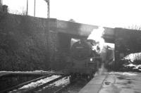 Snow in evidence at West Kilbride on 15 March 1963 as BR Standard class 4 no 80049 brings a Largs train under Law Brae and into the platform.  <br><br>[R Sillitto/A Renfrew Collection (Courtesy Bruce McCartney)&nbsp;15/03/1963]