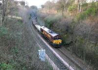 A permanent way train heading for Millerhill yard running through the deep cutting between Craiglockhart and Morningside Road on the Edinburgh 'sub' in January 2005. The locomotive is EWS 66106. <br><br>[John Furnevel&nbsp;06/01/2005]