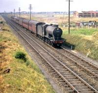 A train approaching Saughton Junction from the north, Edinburgh bound, on 29 July 1959. Locomotive is St Margarets J39 0-6-0 no 64795. <br><br>[A Snapper (Courtesy Bruce McCartney)&nbsp;29/07/1959]